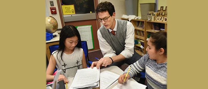 Trumbaurersville Elementary School Principal Adam Schmucker interacts with fifth-grade students in their classroom.