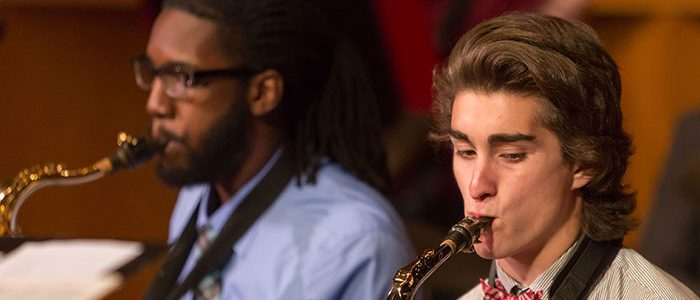 Two students play brass instruments