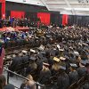 The fieldhouse at commencement filled with graduating students, faculty and administrators.