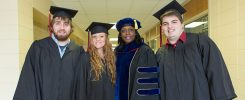 Joshua Pope, Madison Pope, Dr. Kimberly Adams, and Michael Pope prepare for graduation from East Stroudsburg University.