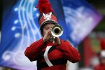 Female Trumpet player on the football field playing