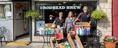 Warrior Food pantry donations on display in front of Brodhead Brew
