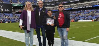 Dr. Solis being presented with award at Baltimore Ravens Stadium