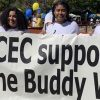 3 students holding a banner that says CEC Support the Buddy Walk