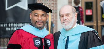 Dr. Harrison Bailey poses for a picture with Dr. Douglas Lare, retired distinguished professor of professional and secondary education,