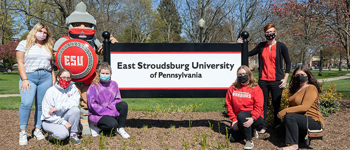 East Stroudsburg University students who took part in a U.S. Centers for Disease Control and Prevention study that looked at mask-wearing on 53 college campuses around the country pose with the Warrior mascot.