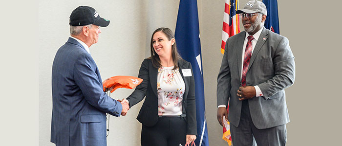 Dr. Mark Erickson, president, Northampton Community College, Elizabeth Reeves, and Kenneth Long, interim president, East Stroudsburg University exchange gifts after a signing agreement at Northampton Community College